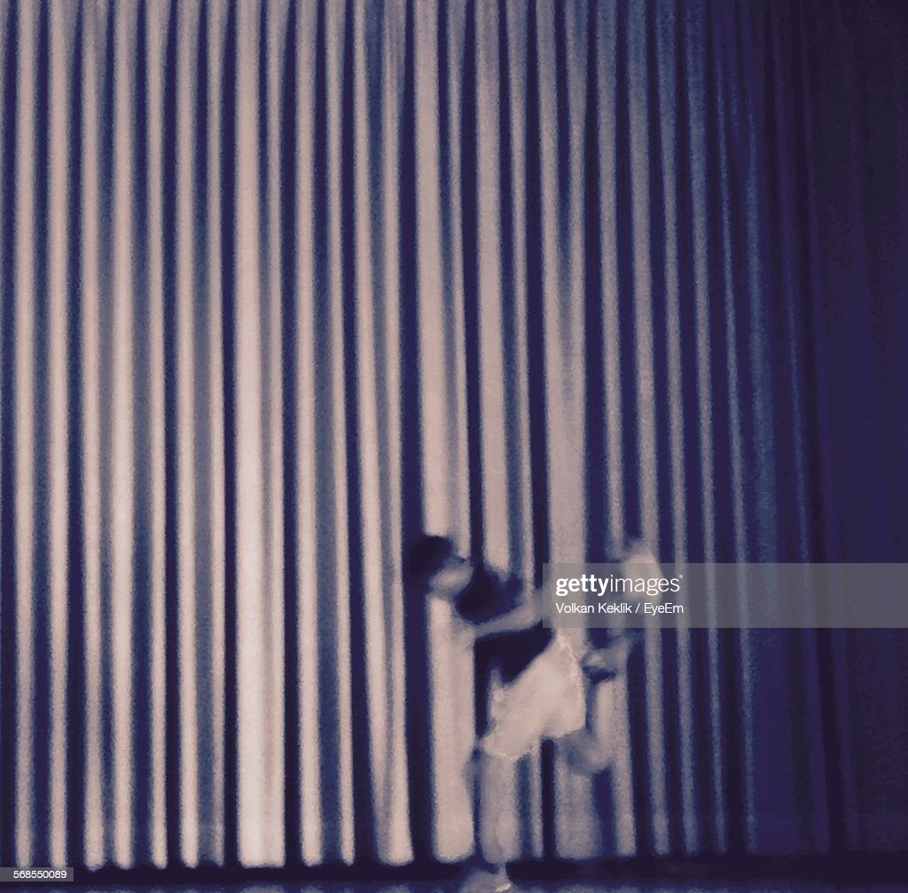 Blurred Image Of Person Playing With Ball Against Wall : Stock Photo