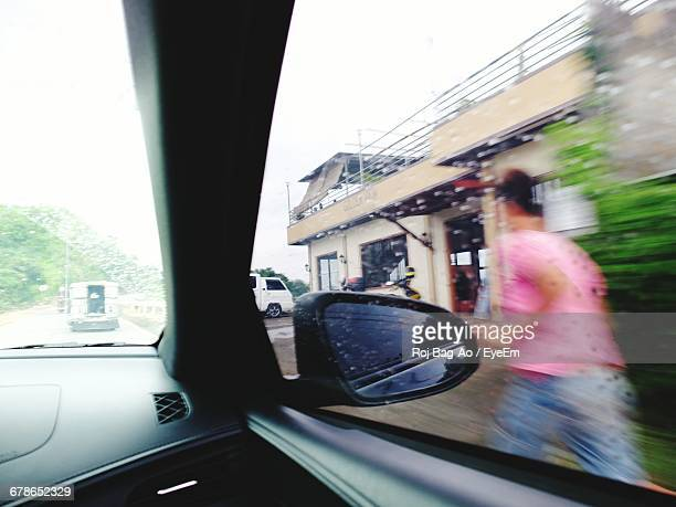 Blurred Image Of Person Seen Through Wet Window