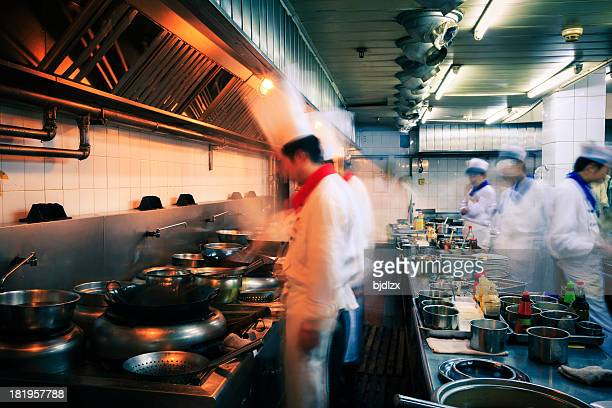 Blurred image of the fast pace of a restaurant kitchen