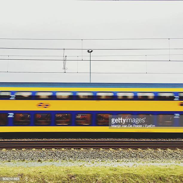 Blurred Image Of Train On Track Against Sky