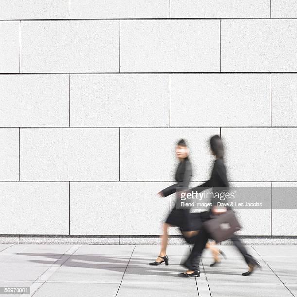 Blurred image of two businesswomen walking