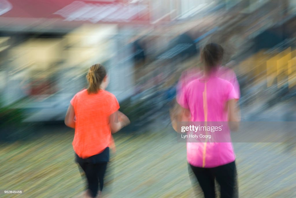 Blurred image of two female joggers : ストックフォト