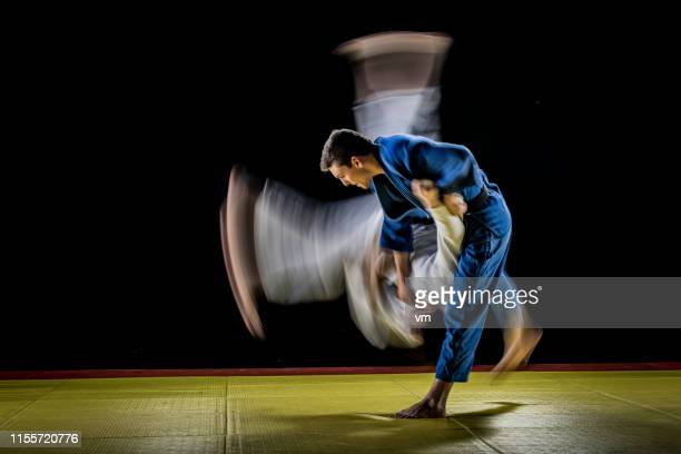blurred judo throw - martial arts stock pictures, royalty-free photos & images
