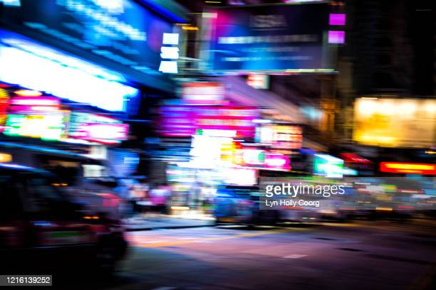 blurred lights and traffic in hong kong street - lyn holly coorg stockfoto's en -beelden