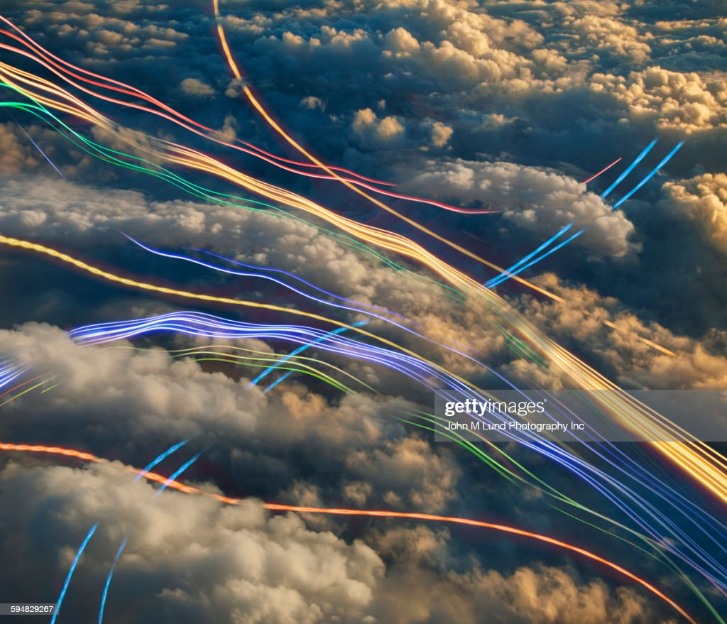 Blurred lights over clouds : Stock Photo