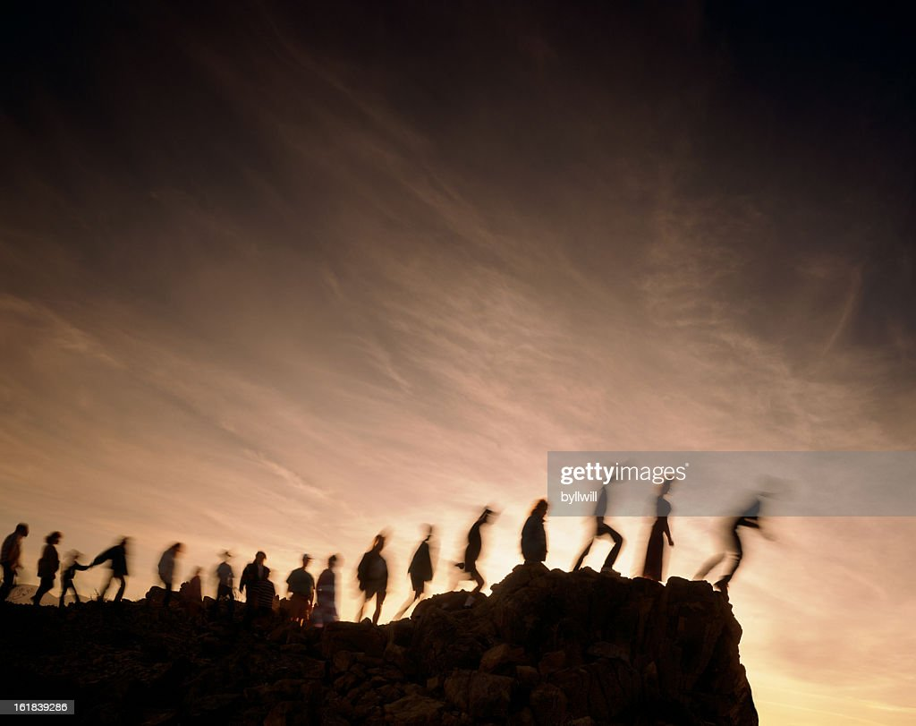 Blurred line of people on the edge of a cliff : Stock Photo