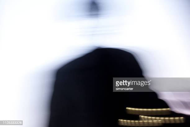 verschwommene mann auf monitor - tax fraud stock-fotos und bilder