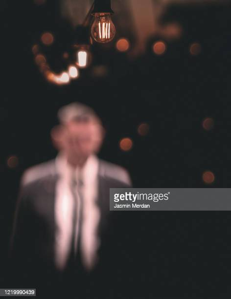 blurred man on night city street in dark - film festival fotografías e imágenes de stock