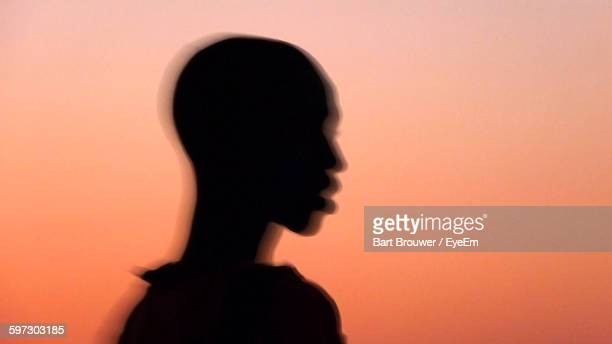 blurred motion boy against sunset sky - gambia stock pictures, royalty-free photos & images