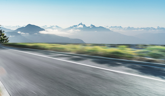 blurred motion country road toward snow mountains - gettyimageskorea