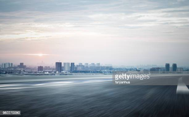 blurred motion elevated road travel through city of suzhou - urban road stock pictures, royalty-free photos & images