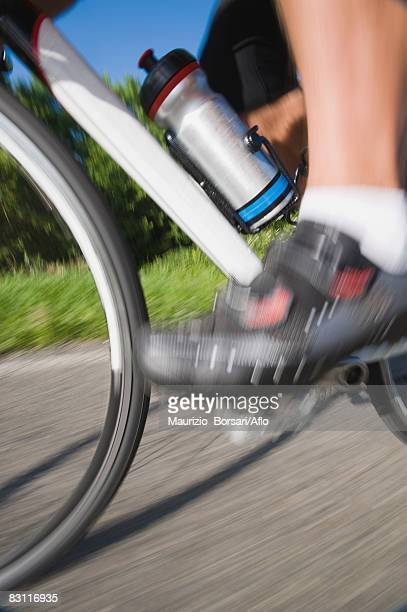 blurred motion of a cyclist pedaling - pedal stock pictures, royalty-free photos & images