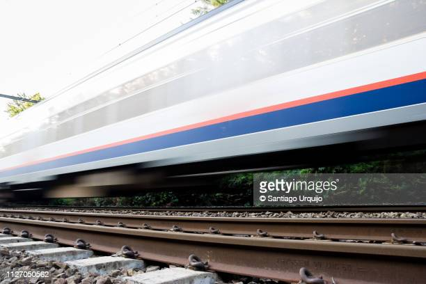 blurred motion of a passing train - moving past stock pictures, royalty-free photos & images