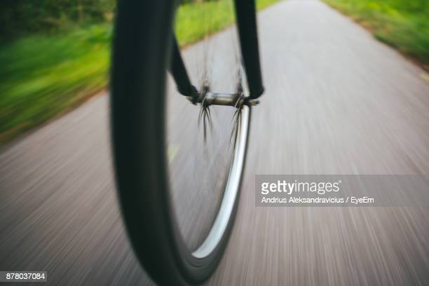 Blurred Motion Of Bicycle Wheel On Road