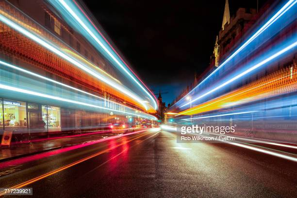blurred motion of bridge at night - motion blur stock photos and pictures