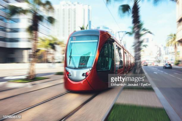 blurred motion of cable car moving in city - casablanca photos et images de collection