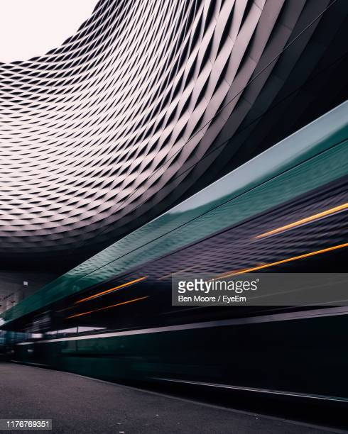 blurred motion of cable car on road in city - basel switzerland stock pictures, royalty-free photos & images