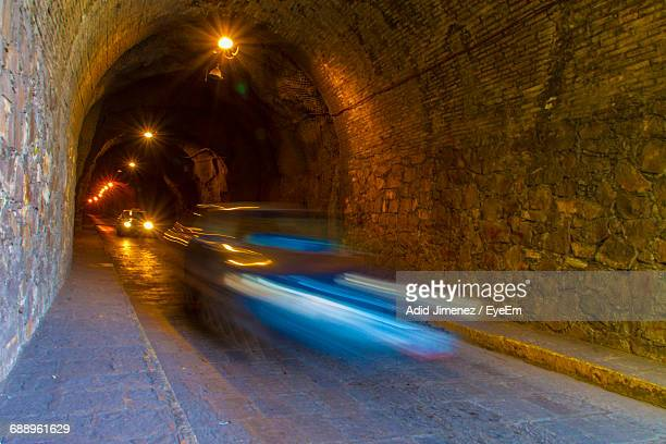 Blurred Motion Of Car Moving In Illuminated Tunnel