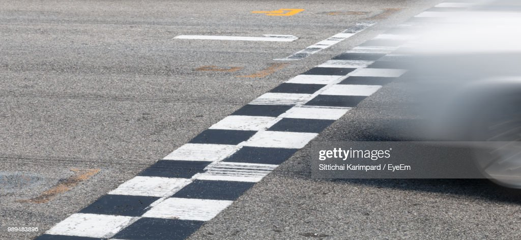 Blurred Motion Of Car Moving On Road : Stock Photo