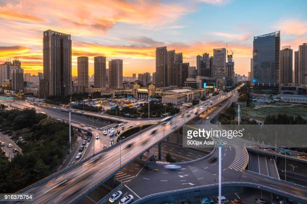 Blurred motion of cars driving on overpass at sunset, Shenyang, Liaoning, China