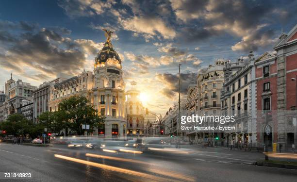 Blurred Motion Of Cars On Gran Via During Sunset In City