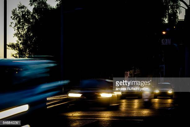 Blurred Motion Of Cars On Street At Dusk