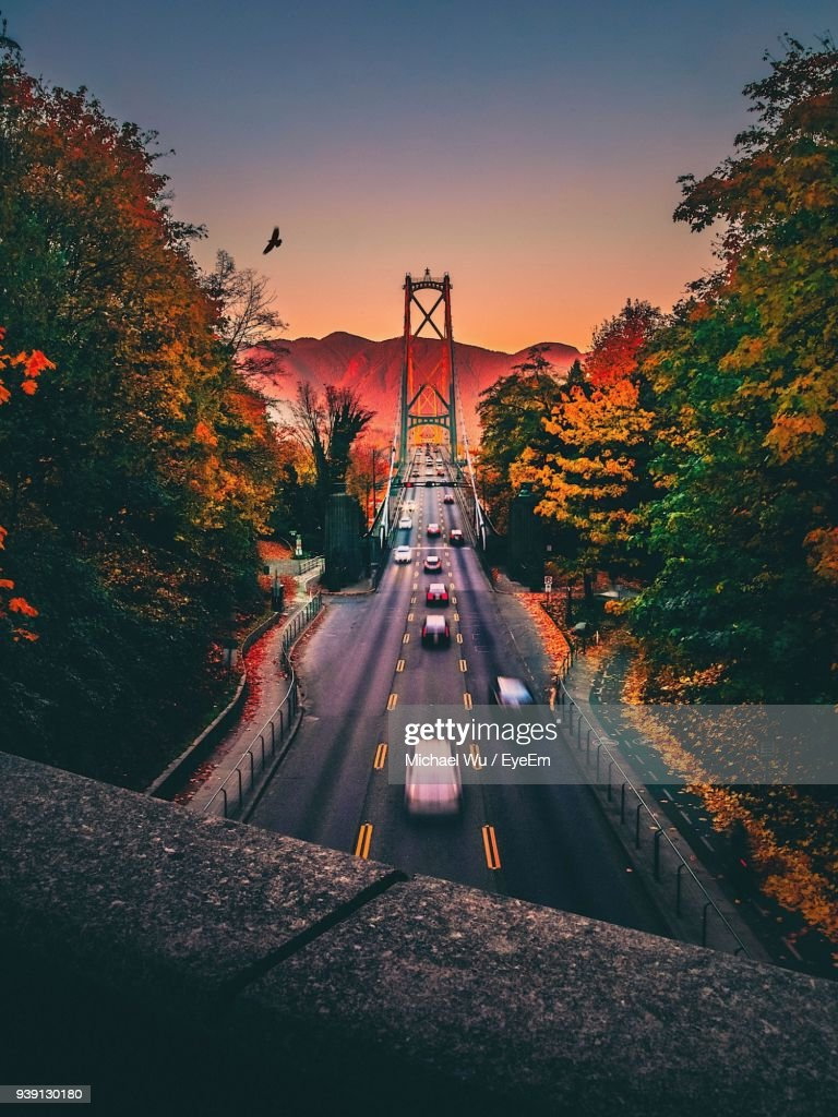 Blurred Motion Of Cars On Suspension Bridge During Sunset : Stock Photo