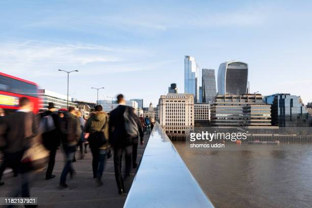 blurred motion of city workers during rush hour - central london stock pictures, royalty-free photos & images