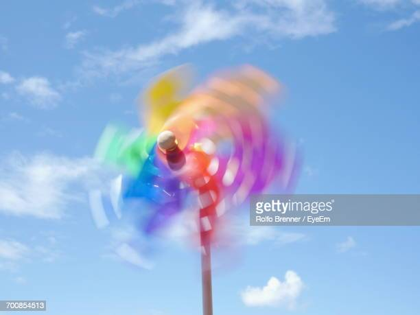 Blurred Motion Of Colorful Pinwheel Against Sky