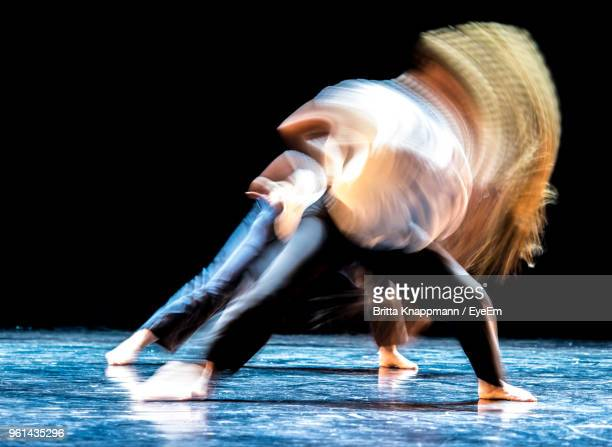 Blurred Motion Of Dancers Dancing On Stage