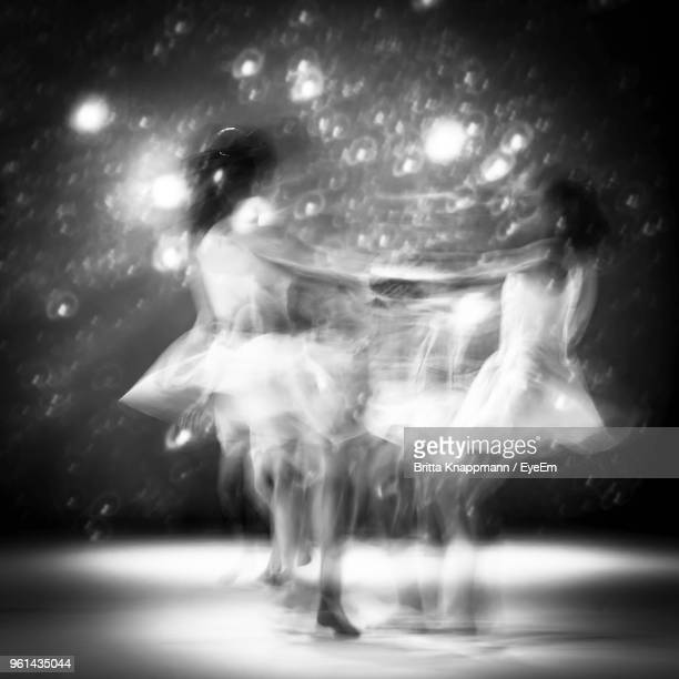 Blurred Motion Of Female Ballet Dancers Dancing On Stage