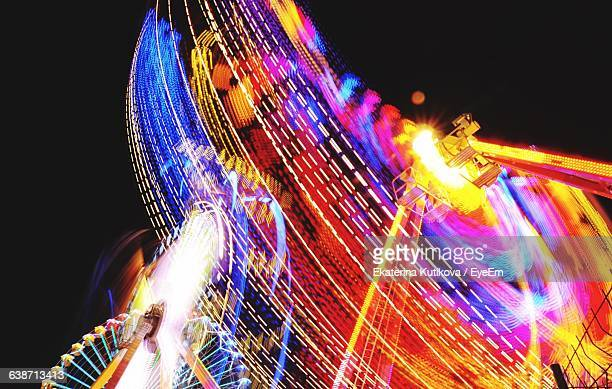 Blurred Motion Of Ferris Wheel At Night