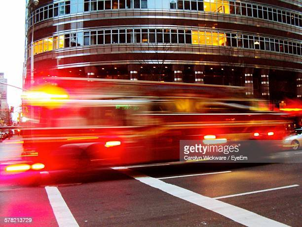 Blurred Motion Of Fire Engine On Road In City