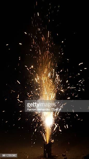 blurred motion of firework at night - sparks stock pictures, royalty-free photos & images