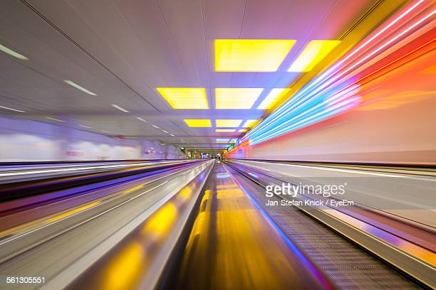 Blurred Motion Of Illuminated Moving Walkway At Airport