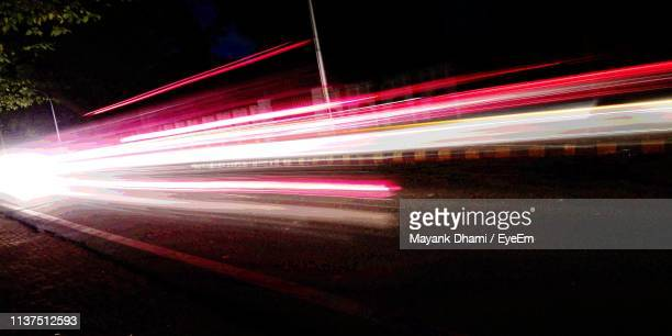 blurred motion of light trails on road at night - red light stock pictures, royalty-free photos & images