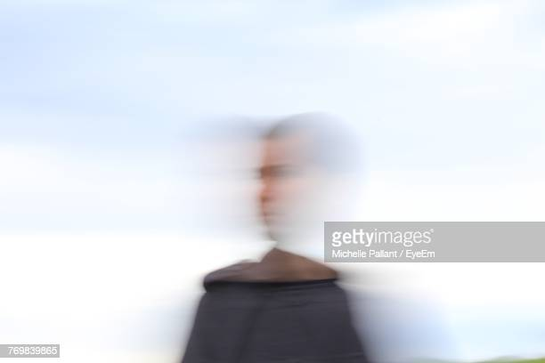 blurred motion of man against sky - blurred motion stock pictures, royalty-free photos & images