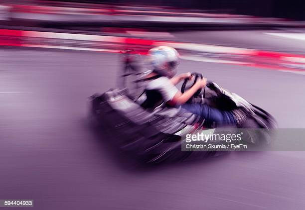 Blurred Motion Of Man Go-Carting