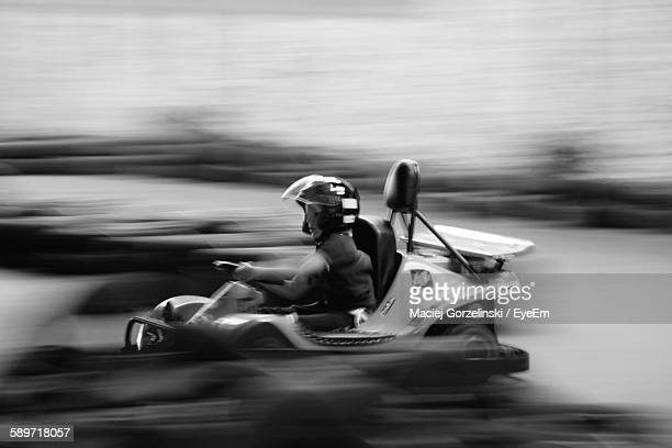 Blurred Motion Of Man In Go-Cart Race