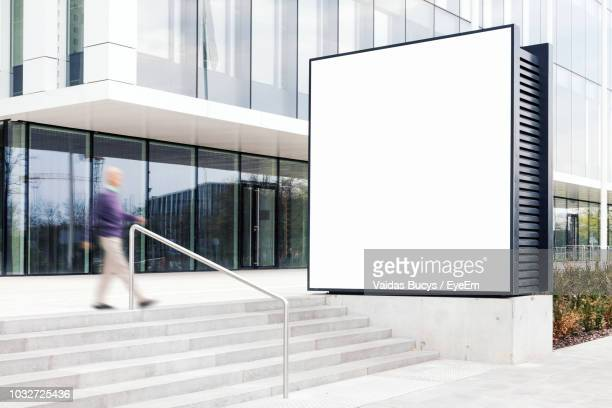 Blurred Motion Of Man Moving Down On Steps