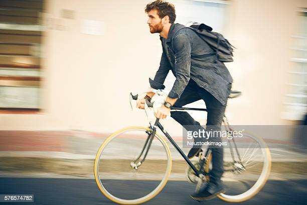 Blurred motion of man riding bicycle