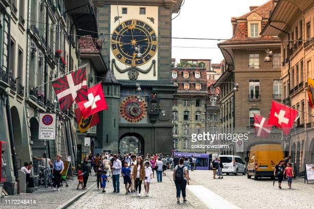 blurred motion of people and tourists on streets of bern, switzerland - bern stock photos and pictures