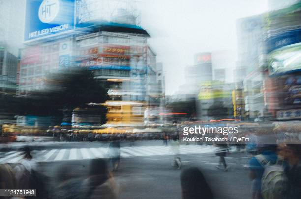 Blurred Motion Of People And Vehicles On Road In City
