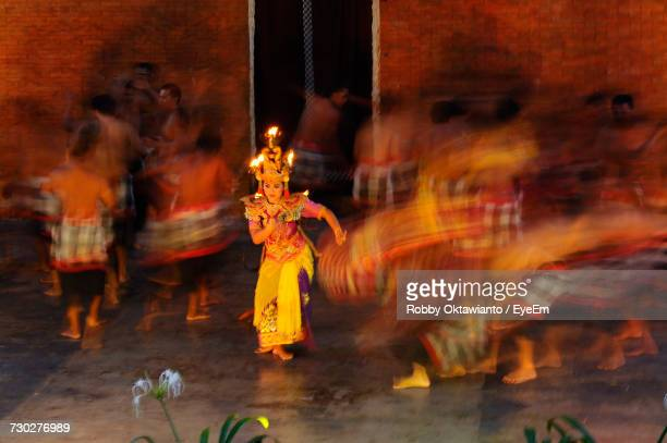 Blurred Motion Of People Performing Kecak Dance On Stage
