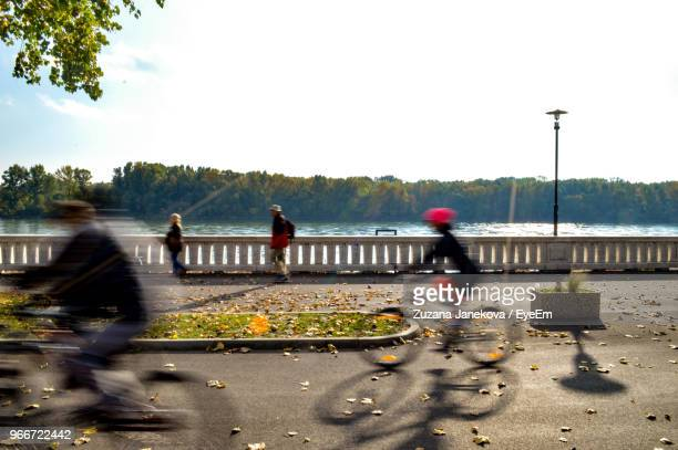 Blurred Motion Of People Riding Bicycles On Road