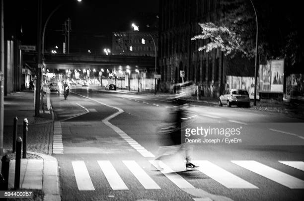 Blurred Motion Of Person Crossing City Street