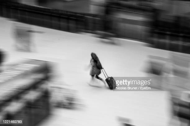blurred motion of running people in train station - waterloo railway station london stock pictures, royalty-free photos & images