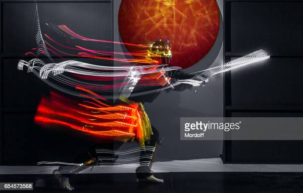 Blurred Motion Of Samurai In LED Clothing
