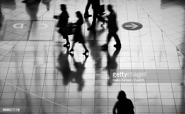 Blurred Motion Of Silhouette People Walking At Subway Station