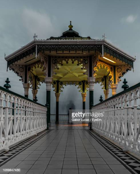 blurred motion of silhouette person standing under gazebo - brighton beach england stock pictures, royalty-free photos & images